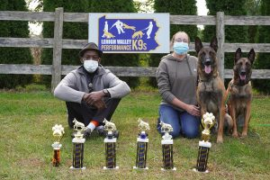 k-9 institute employees posing with awards
